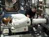 Expedition 28 Flight Engineer Mike Fossum prepares Robonaut for its first activation.