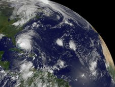 GOES-13 saw Hurricane Irene moving through the Bahamas (left) and newly born Tropical Depression 10 (far right).