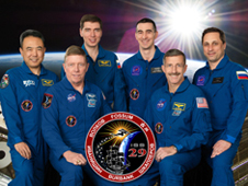 The Expedition 29 crew with an image of the space station and Earth in the background