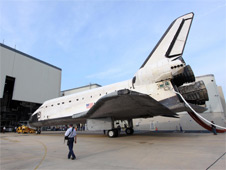 Shuttle Endeavour is pulled into Orbiter Processing Facility 1.