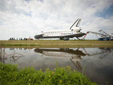 Space shuttle Atlantis is towed to the Orbiter Processing Facility (OPF).