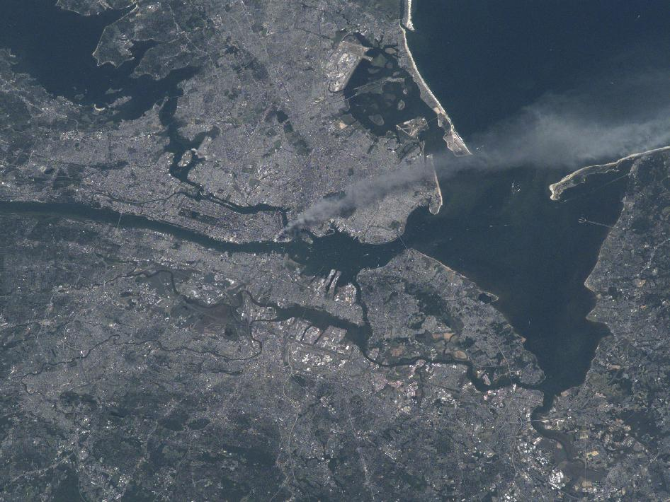 Visible from space, a smoke plume rises from the Manhattan area after two planes crashed into the towers of the World Trade Center. This photo was taken of metropolitan New York City (and other parts of New York as well as New Jersey) the morning of September 11, 2001.
