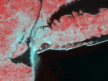 This image from NASA's Terra satellite shows a large plume of smoke streaming southward from the remnants of the burning World Trade Towers in downtown Manhattan yesterday (September 11, 2001). The image was acquired by the Moderate-resolution Imaging Spectroradiometer (MODIS) within a few hours after the terrorist attack.
