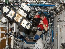 ESA astronaut Paolo Nespoli filming scientific experiments with the ERB-2 camera on board the ISS.