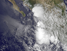 This GOES-11 image from Sept. 1 at 9:45 a.m. EDT shows the remnant clouds of Tropical Depression 8E as a rounded swirl of clouds hugging Mexico's southwestern coastline.