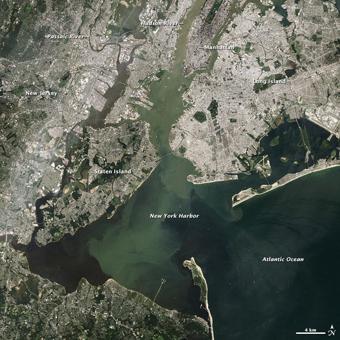 In this true color satellite image from the Landsat 5 satellite on Aug. 31, 2011, pale green and tan water flows past Manhattan and mixes with the darker waters of New York Harbor and the Atlantic Ocean.