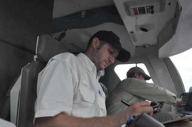 Geologist Jake Bleacher takes notes as Astronaut Bob Behnken drives the Space Exploration Vehicle on an excursion during the 2011 Desert RATS test.