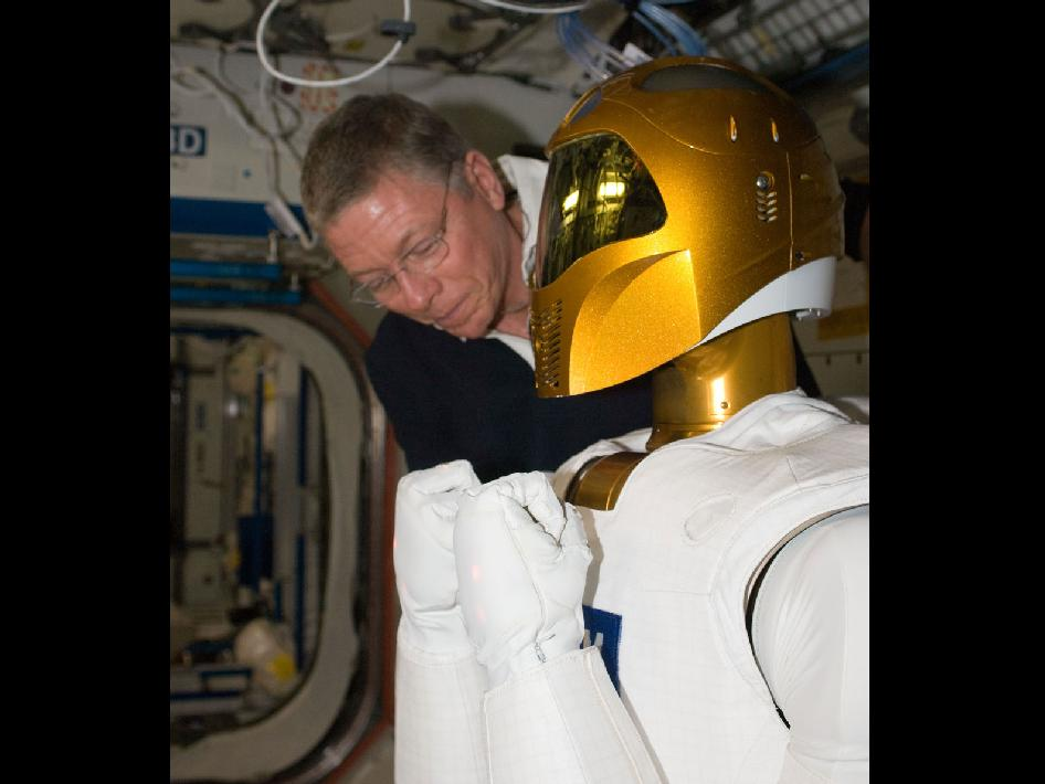 Astronaut Mike Fossum with Robonaut
