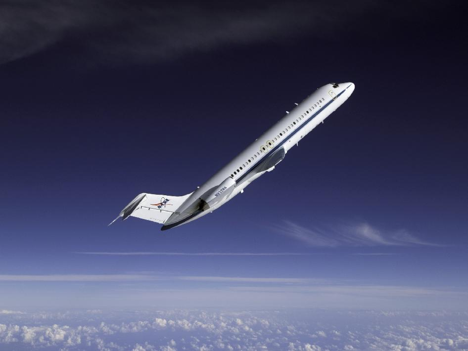 A NASA DC-9 reduced-gravity aircraft during a parabolic flight photographed from a T-38 aircraft
