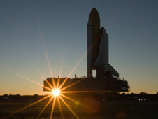 Shuttle Endeavour is silhouetted against the predawn sky during rollout to the launch pad before STS-130