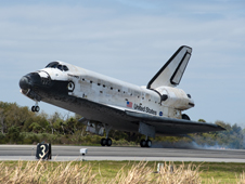 Shuttle Discovery touches down, ending the STS-133 mission