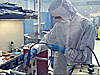 Alejandro Arambula works in a cleanroom lab