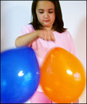 Photograph of two balloons resisting one another with static electricity