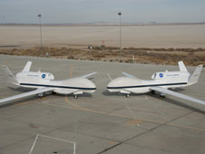 NASA's two Global Hawks lined up nose-to-nose on the ramp at NASA's Dryden Flight Research Center.