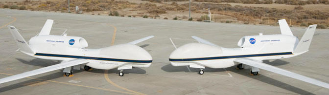Their bulbous noses almost touching, NASA's two Global Hawks lined up nose-to-nose on the ramp at NASA's Dryden Flight Research Center on Edwards Air Force Base.