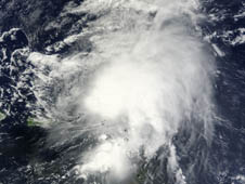 This visible image of Tropical Storm Maria was taken by the MODIS instrument on NASA's Terra satellite at 14:55 UTC (10:55 a.m. EDT) on Sept. 11, 2011 when it was near the Leeward Islands.  Puerto Rico is seen to the left of the storm.