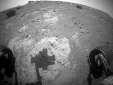 Robotic arm of NASA's Mars Exploration Rover Opportunity casts a shadow on a rock outcrop called 'Chester Lake'