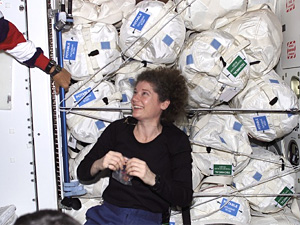 Astronaut Susan Helms with water storage tanks
