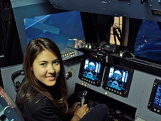 Sabrina Billinghurst, CHAAT Grad Student in the Boeing 777 Cockpit Simulator at NASA Ames' Flight Deck Display Research Laboratory.