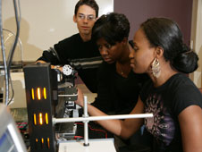 NCCU students, including Physics majors Joseph Estevez (left) and Nene Ugoeke (right), in the modern physics laboratory.