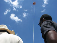 Summer intern John Moore and Dr. Jose Fuentes operate a winch to raise and lower the moored balloon carrying instruments.