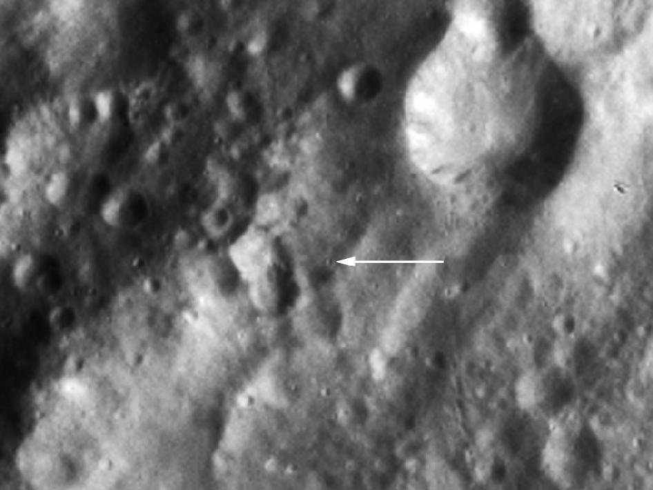 Claudia (arrow), a tiny crater of about 1500 yards (500 meters) in diameter