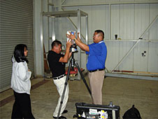 Three students with a laser scanner