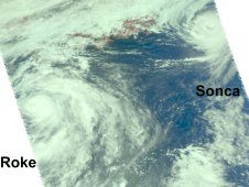 This visible image from the AIRS instrument shows Tropical Storm Roke (left) and Tropical Storm Sonca (right)