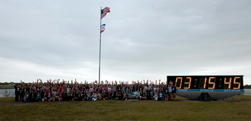 NASA Twitter followers, who participated in the STS-134 Tweetup are seen together by the launch clock, Friday, April 29, 2011, at Kennedy Space Center in Cape Canaveral, Florida.