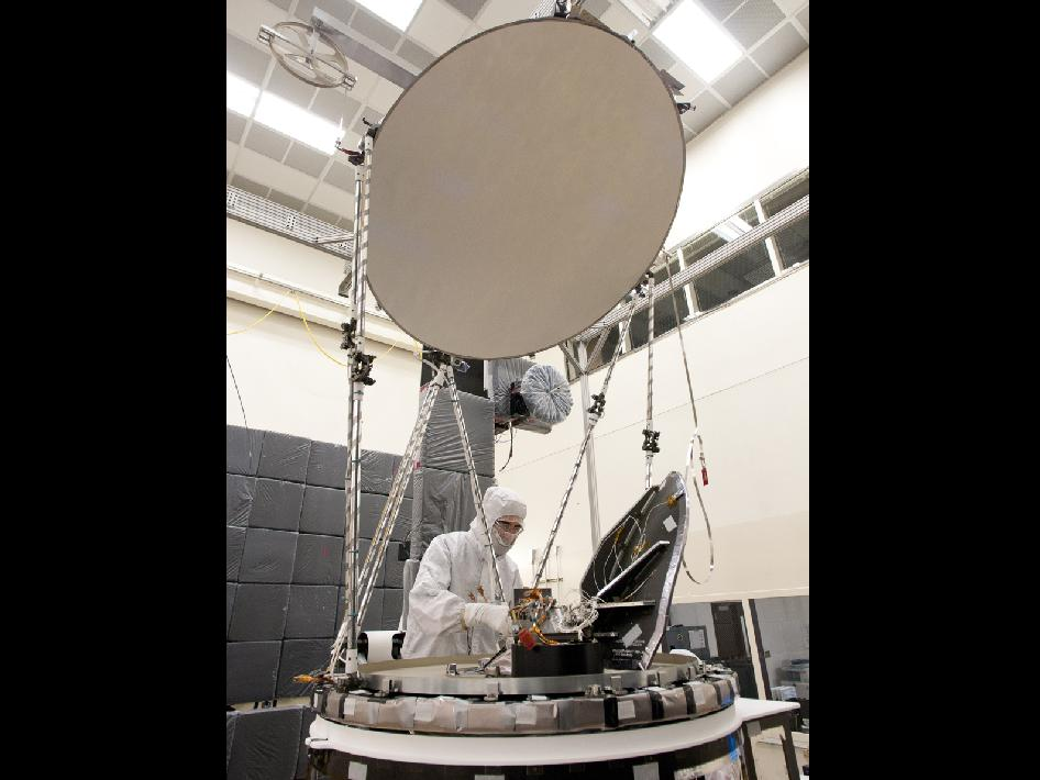A test technician completes the final electrical integration of the GPM Microwave Imager (GMI) at Ball Aerospace.