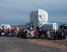 The 2011 Desert RATS crew and support team pose in front of the Deep Space Habitat and two Multi-mission Space Exploration Vehicles.