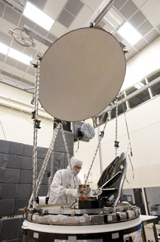 A test technician completes final integration of the GPM Microwave Imager (GMI) at Ball Aerospace.
