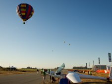 Hot air balloons pass over the campus of the 2011 Green Flight Challenge.