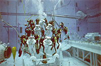 A picture of astronauts and scuba divers underwater