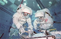 Astronauts working underwater