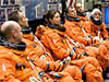 Astronauts in orange suits
