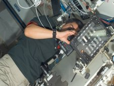 Astronaut Dan Tani photographing the BCAT-3 Sample Module aboard the International Space Station. (NASA)
