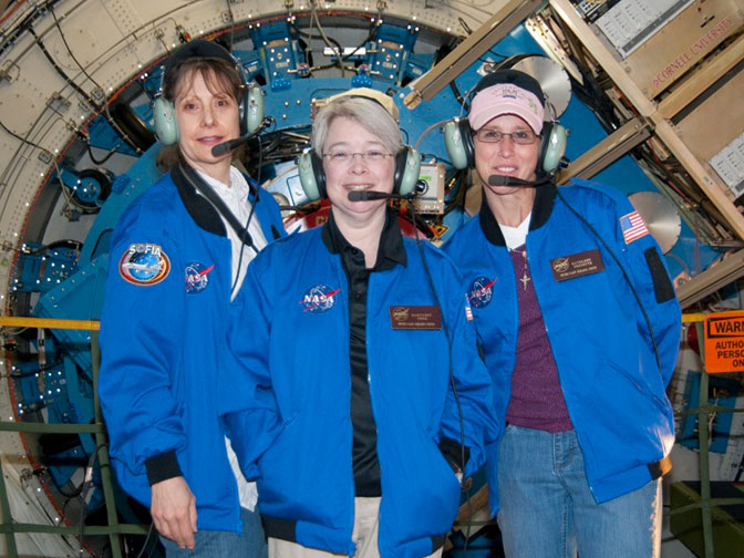 Pamela Harman, SOFIA Airborne Astronomy Ambassador program manager (left) Pamela Harman, and teachers Margaret Piper from Lincoln Way High School in Frankfort, Il. (center) and Kathleen Fredette from Desert Willow Intermediate School in Palmdale, Calif., stand before the SOFIA telescope