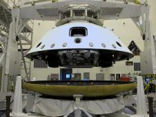 NASA's Mars Science Laboratory rover, Curiosity, is being placed on the spacecraft's heat shield.