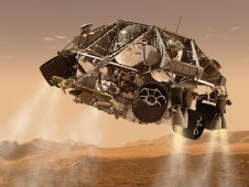 Artist concept shows Curiosity rover touching down on the surface of Mars.