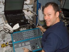 Astronaut Michael Lopez-Alegria, Expedition 14 Commander, holds the Ultrasound Transducer Probe assembly