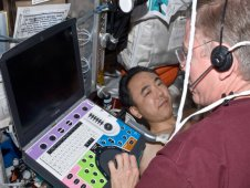 Expedition 29 Commander Mike Fossum scans JAXA crew member Satoshi Furukawa using the Ultrasound 2