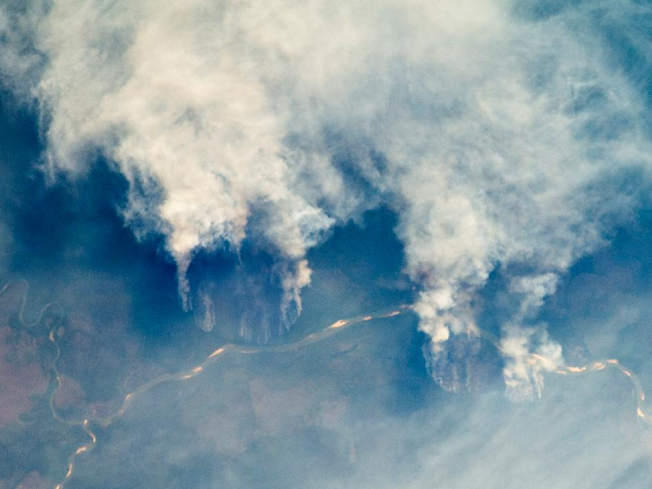 photograph of Brazil's Rio Xingu and nearby fires taken from ISS