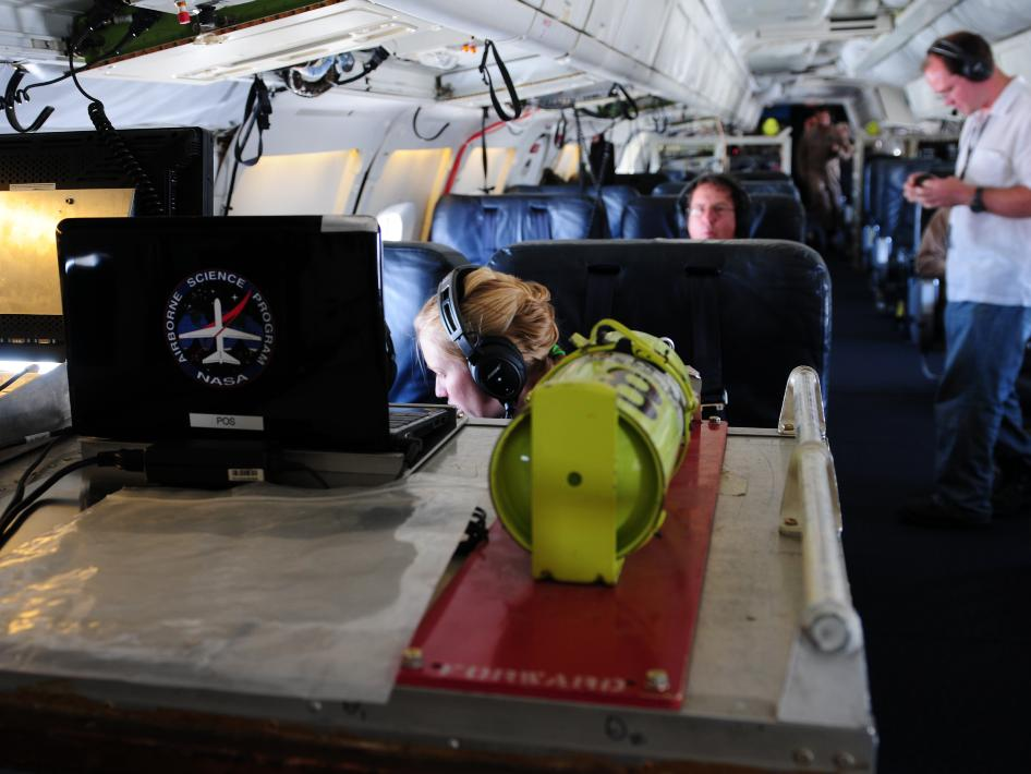 Inside the NASA DC-8, IceBridge scientists calibrate their instruments during a test flight over the Pacific Ocean, Wednesday October 5, 2011.