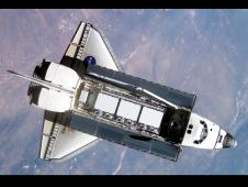 Atlantis approaches the International Space Station during STS-112 rendezvous and docking operations