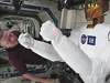 Expedition 29 Commander Mike Fossum and Robonaut 2