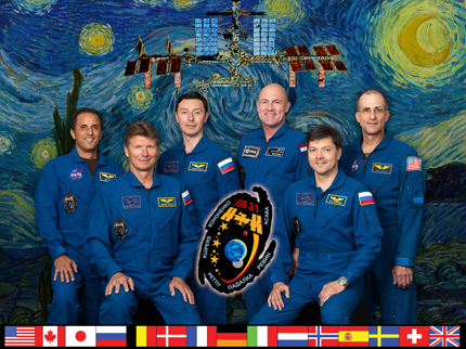 ISS031-S-002 -- Expedition 31 crew portrait