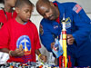 Astronaut and boy with LEGO model rocket