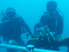 The NEEMO 15 crew outside the Aquarius undersea habitat. Photo credit: NASA