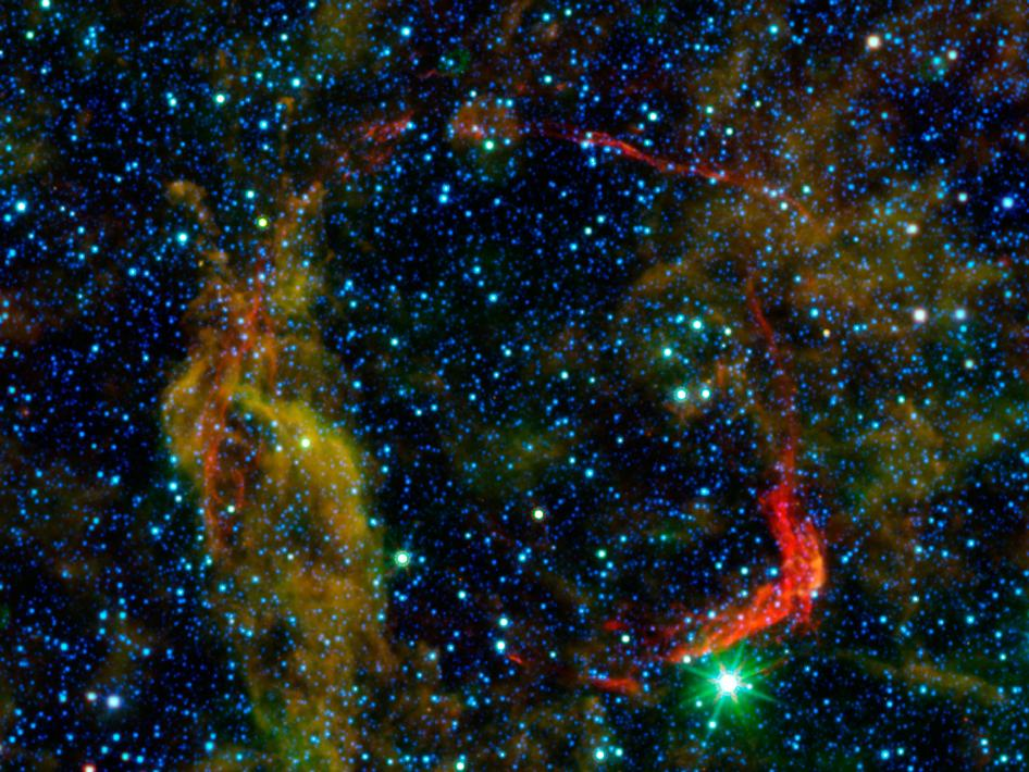Infrared images from NASA's Spitzer Space Telescope and Wide-field Infrared Survey Explorer (WISE) are combined in this image of RCW 86